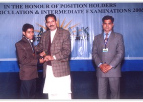 Dr. Ehsan Malik presented Gold Medal & Shield to Ammar Zia – 1st Overall Intermediate. (2006)
