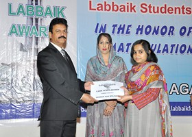 Nisar Zia Chairman LFW presented Cash Scholarship to Amina Siddique (2013)