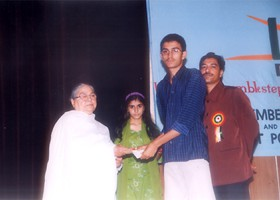 Sr. Headmistress Creseant School presented Cash Scholorshp to Mirza Muhammad Ali. (2004)
